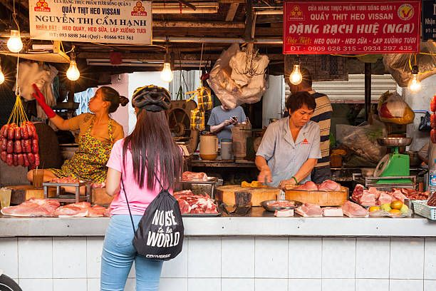Female Butcher In A Street Market Stock Photos, Pictures & Royalty ...